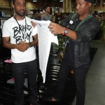 Ish gives celebrity blogger Marcus Troy a DNTN ANDY WARHOL tshirt as a token of appreciation